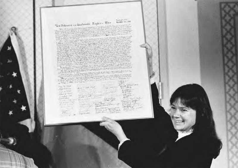 Helga Zepp-LaRouche, founder of the international Schiller Institute, holds its founding document, the Declaration of the Inalienable Rights of Man