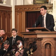 Master of Ceremonies, Matthew Ogden, Moderates the Introductory Speeches Before the Concert