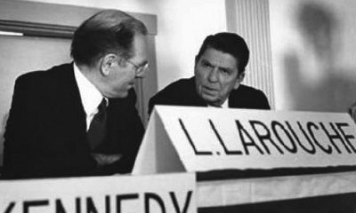 LaRouche speaks to Ronald Reagan at a candidates forum in New Hampshire during the 1980 presidential election campaign.